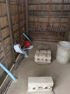 Dry pit toilet instructions: Lift the cement lid, do your business but pee separately in the red container. Throw toilet paper and ash into the pit, close the lid, throw the pee out onto the grass outside.
